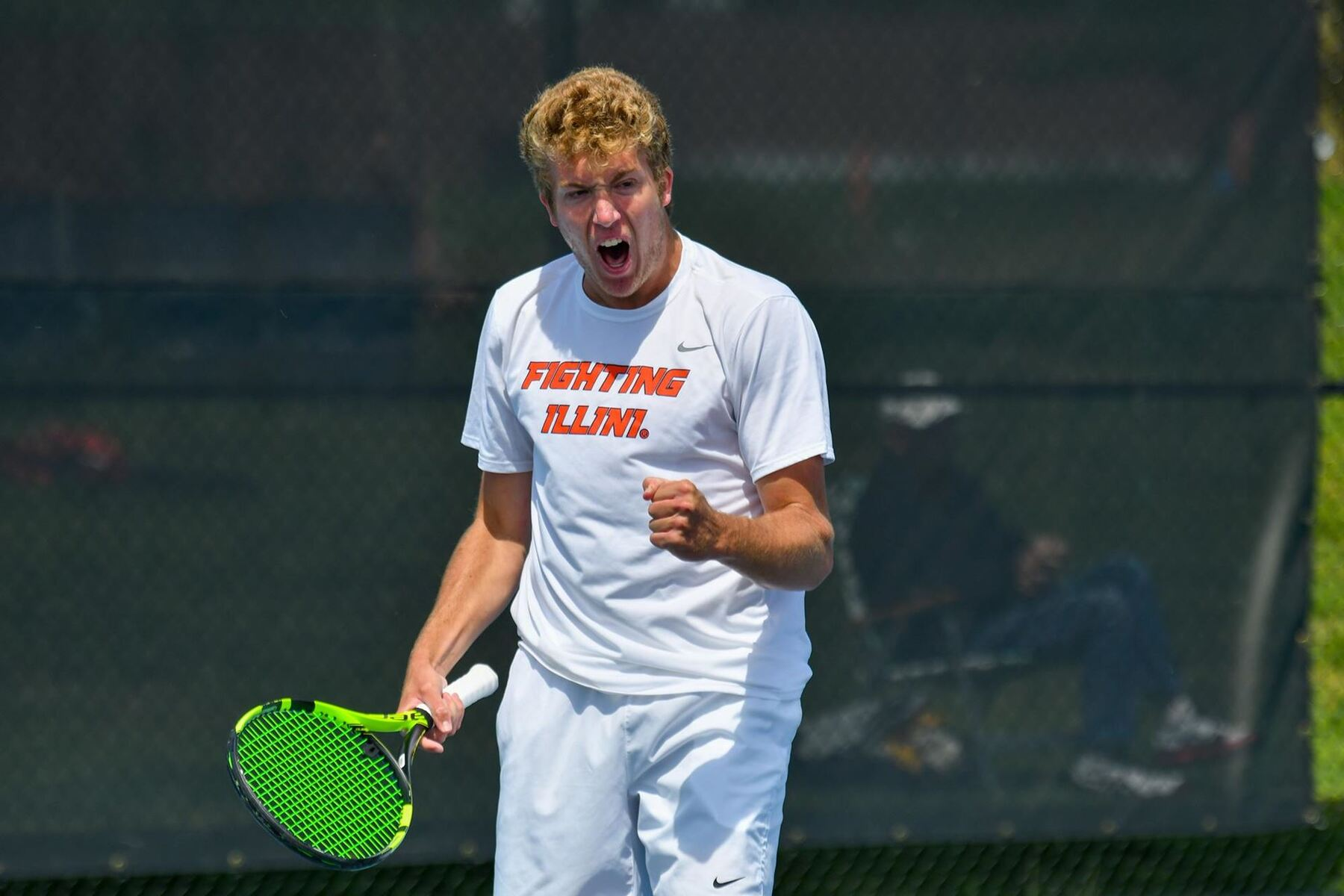 a tennis player reacts to winning a volley