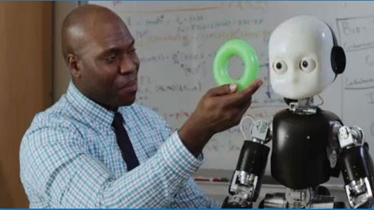 image of Ph.D. student Onyeama Osuagwu and Bert, the robot