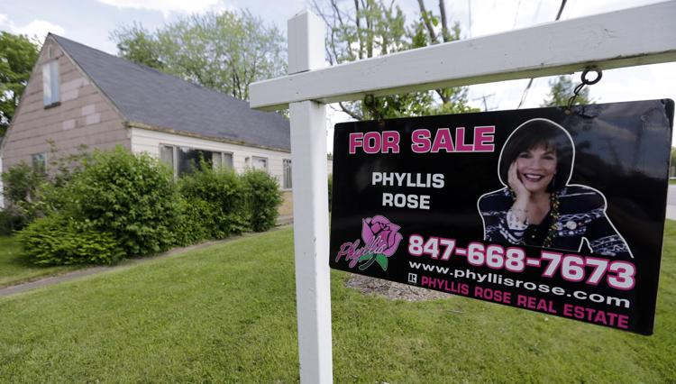 In this Sunday, June 16, 2013 photo, a home is for sale in Glenview, Ill.  AP Photo/Nam Y. Huh