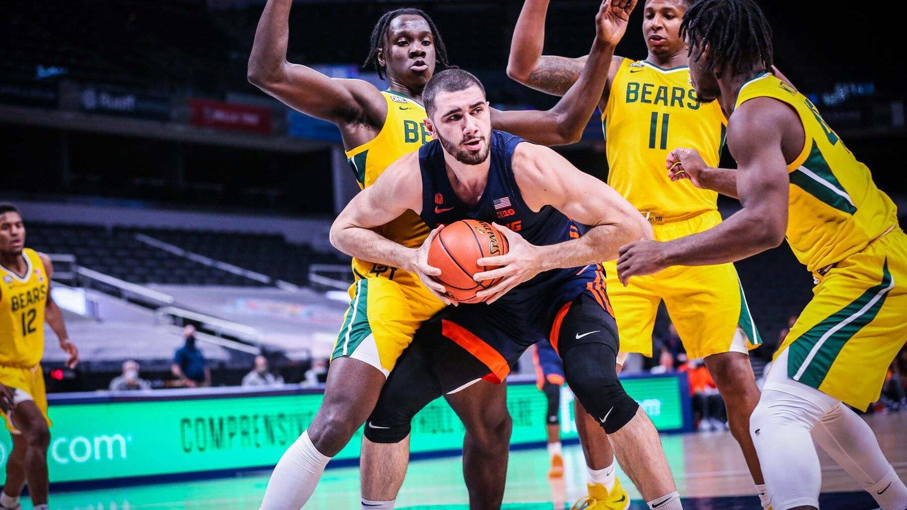 Giorgi Beshanishvili, surrounded by Bears defenders under the basket, prepares to post up