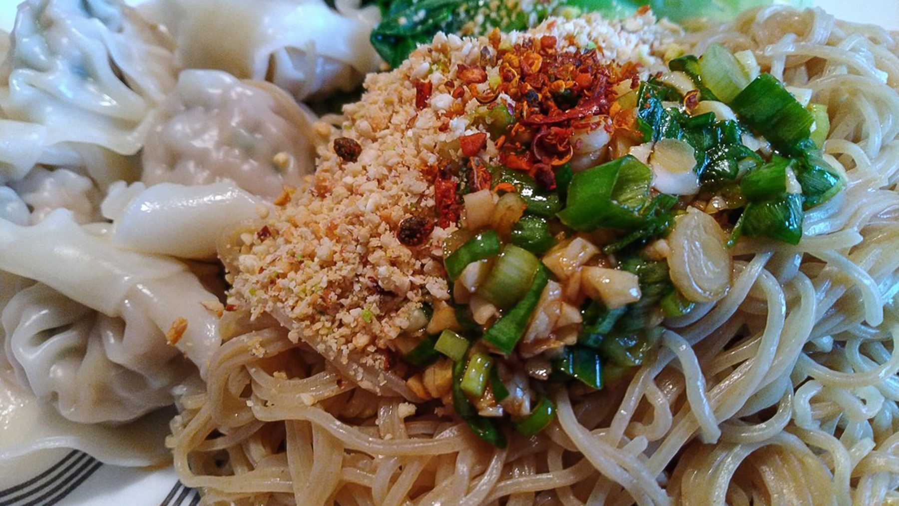 Taiwanese dish of wonton noodles with chili and crushed peanuts.  Photo by Hueih Kan Dung
