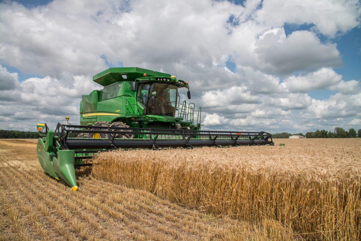 Combine harvesting corn in Illinois. Illinois Farm Bureau image via Creative Commons