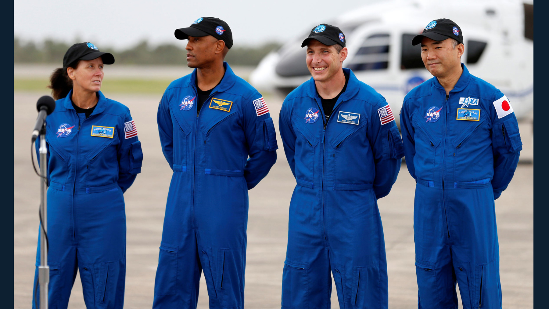 Alumnus Mike Hopkins is second from right in this image of the four crew members. JOE SKIPPER/REUTERS