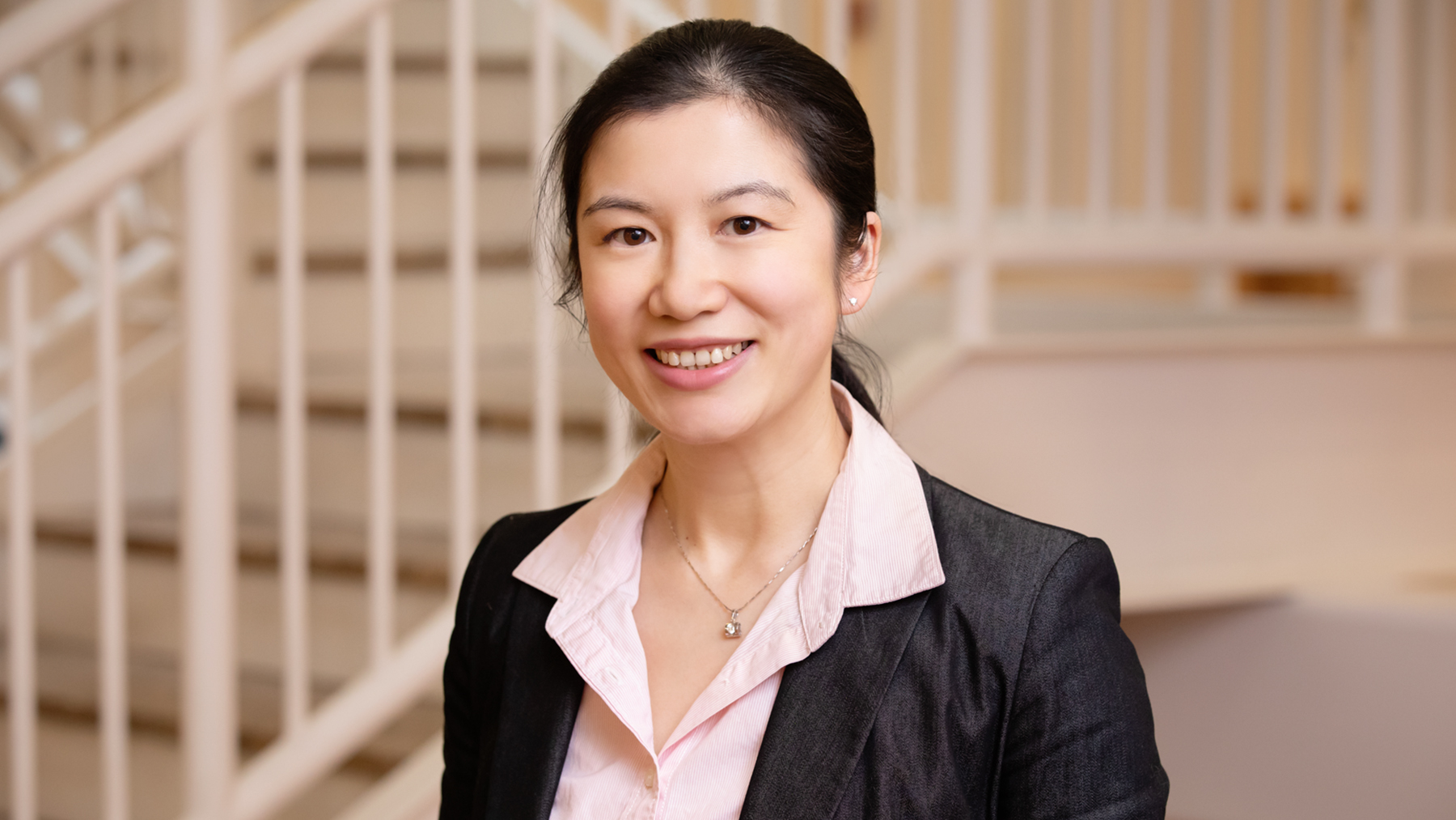 Yilan Xu, a professor of agricultural and consumer economics at Illinois, shows that taming domestic transmission of COVID-19 ought to be prioritized over international travel bans or restrictions aimed at limiting the threat of the virus from abroad.  Photo by L. Brian Stauffer