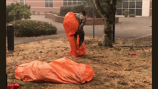 Oregon National Guard members get refresher training on emergency fire shelters prior to deployment to Oregon wildfires.