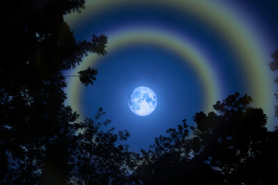 full moon with 'moondoggies' - haloes circling the moon. (Credit: Darkfoxelixir/Shutterstock)