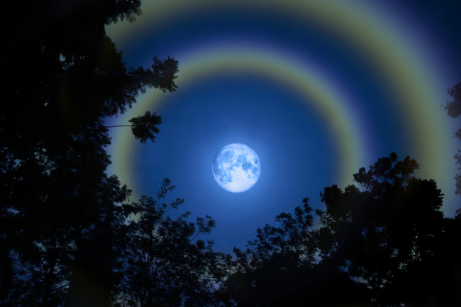 full moon with 'moondoggies' - haloes circling the moon. (Credit: Darkfoxelixir/Shutterstock)