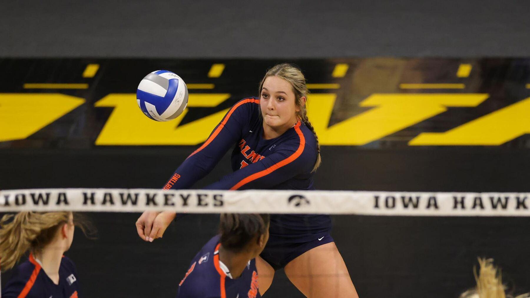 redshirt freshman Ellie Holzman sets the ball for teammates