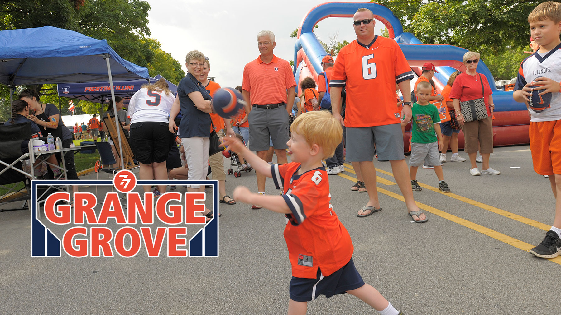 image of illini fans tailgating, with children playing