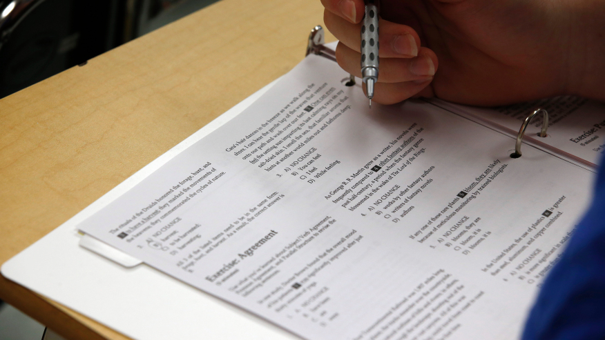 A student looks at questions during a college test preparation. (AP Photo/Alex Brandon)