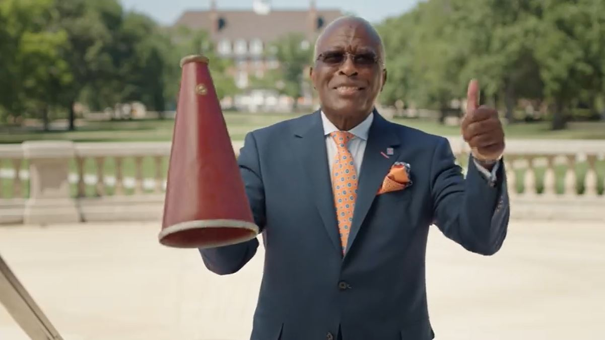 Chancellor Jones gives a ''thumbs up' to students showing their Illini spirit