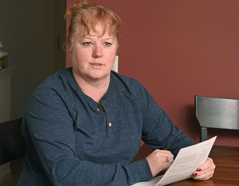 Tracy Syslo, an HR representative, is one of more than 350,000 Illinois residents whose personal identities were used in fraudulent unemployment claims in recent months. (Brian OMahoney / Pioneer Press