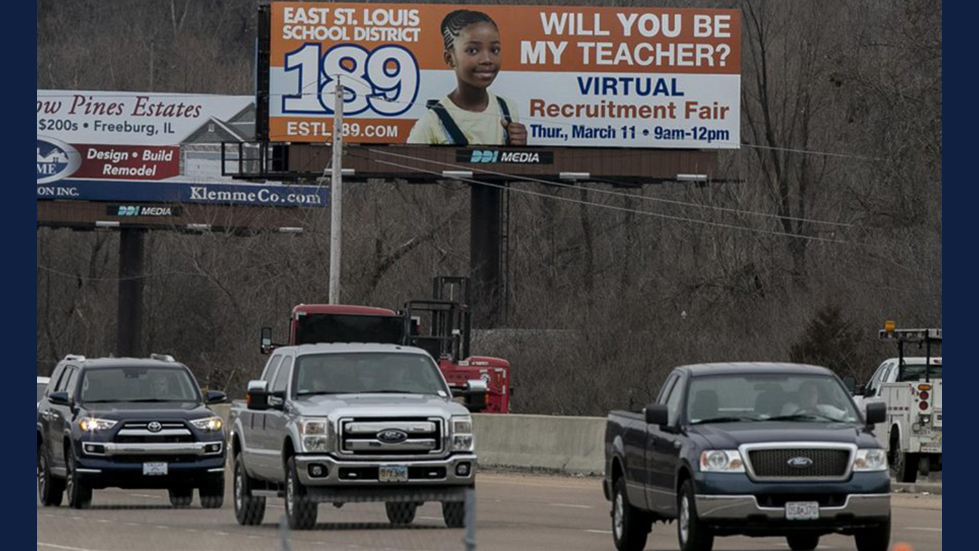 A billboard located along Illinois State route 15 in Centreville advertises for teachers for East St. Louis School District 189. Photo credit: Belleville News-Democrat.
