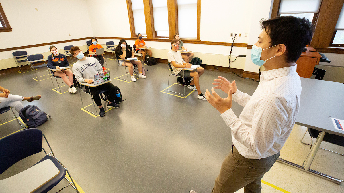 masked instructor teaches socially distanced students in a U of I classroom
