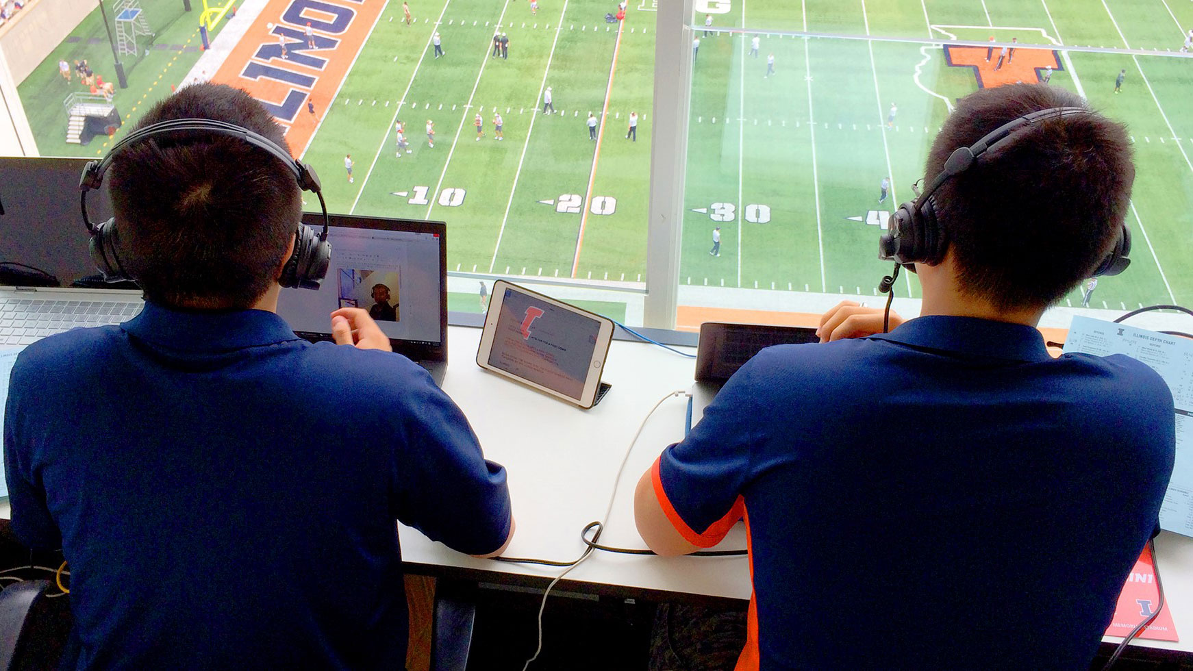 image of students Liaohan He and Yekai Lu calling the game against Kent State on September 5
