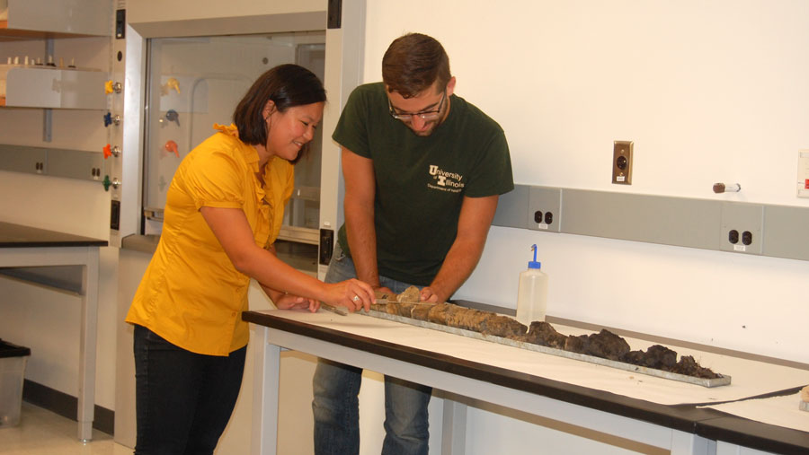 image of students analyzing a soil sample