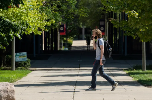 A person wearing a mask walks around the campus of University of Illinois at Chicago Friday afternoon, Aug. 14, 2020. | Pat Nabong/Sun-Times Pat Nabong/Sun-Times, Pat Nabong/Sun-Times
