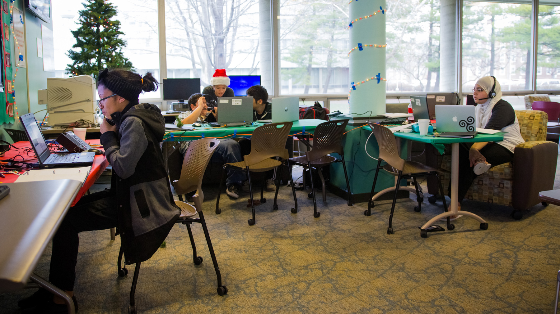 image of students working the dial-a-carol phone lines