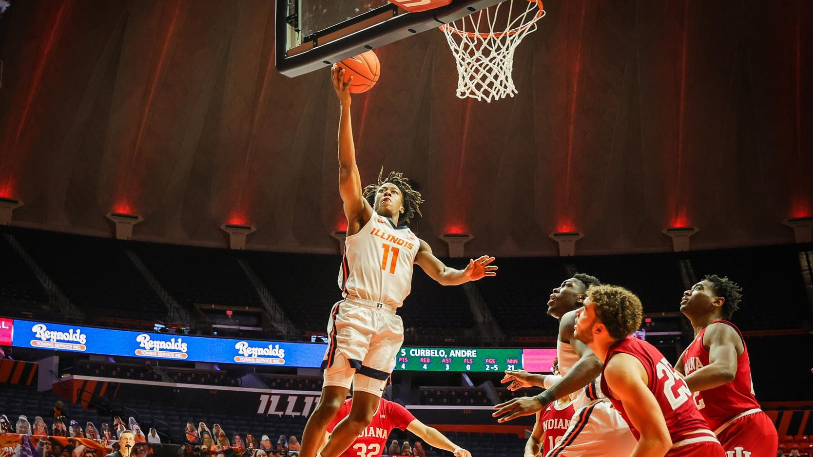 Ayo Dosunmu scores on a layup against Indiana defenders