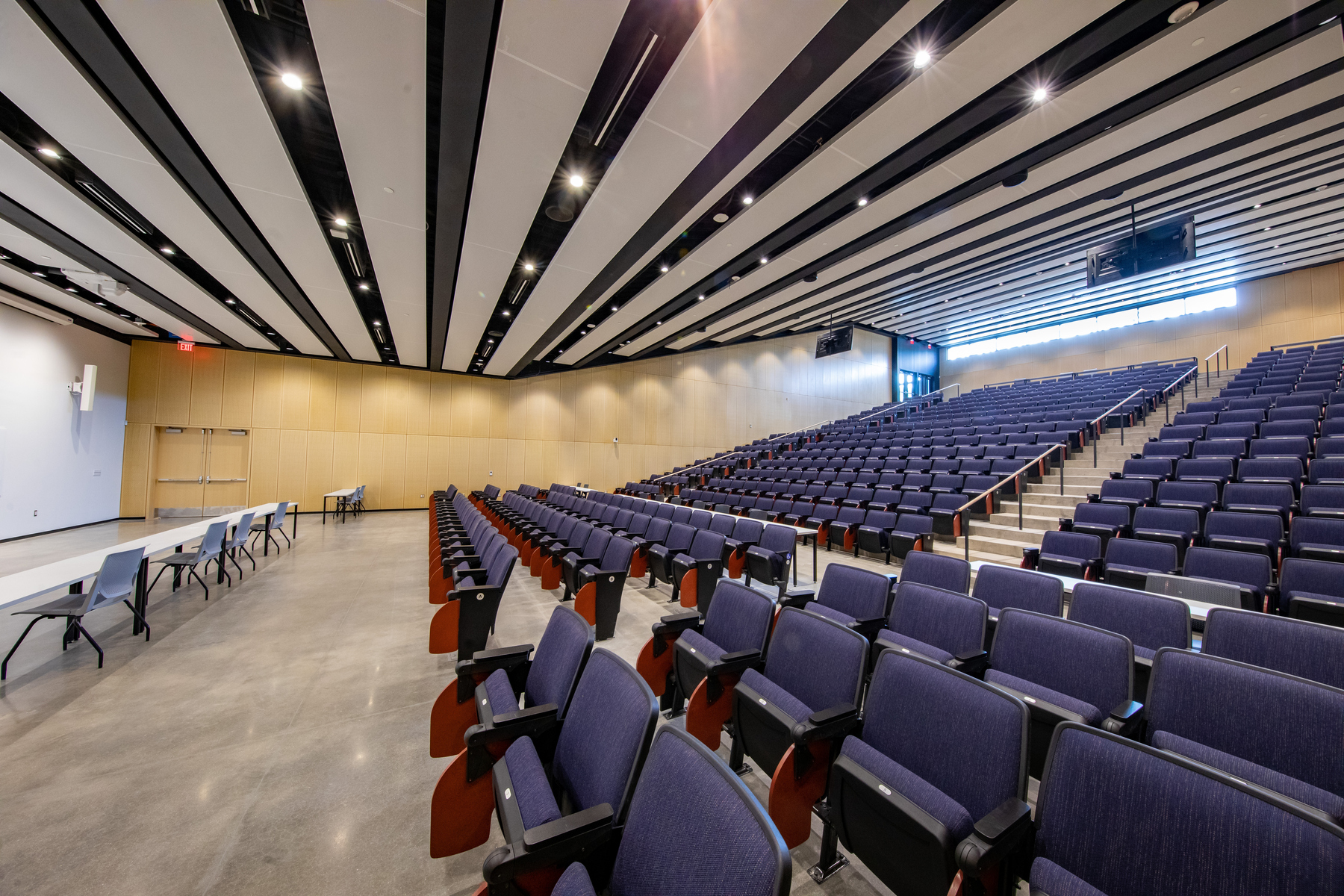 large lecture hall with rows of ascending seats