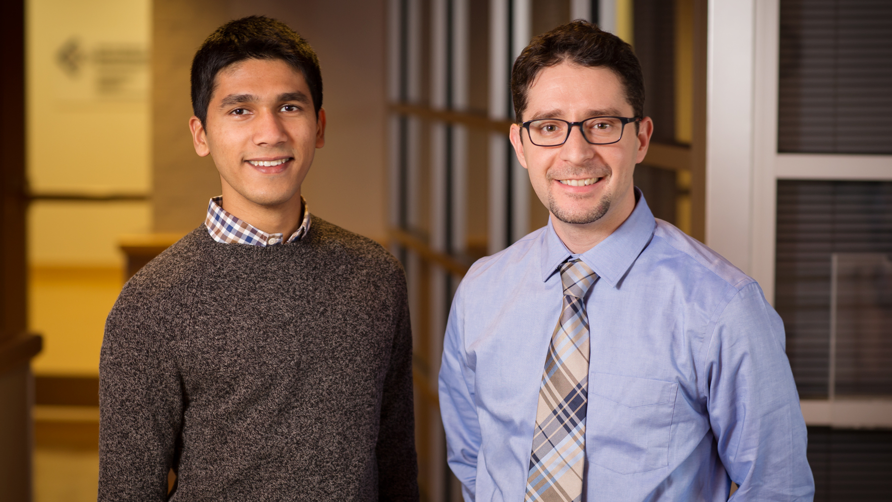 image of mechanical science and engineering professor Kyle Smith and graduate student Rylan Dmello by L. Brian Stauffer