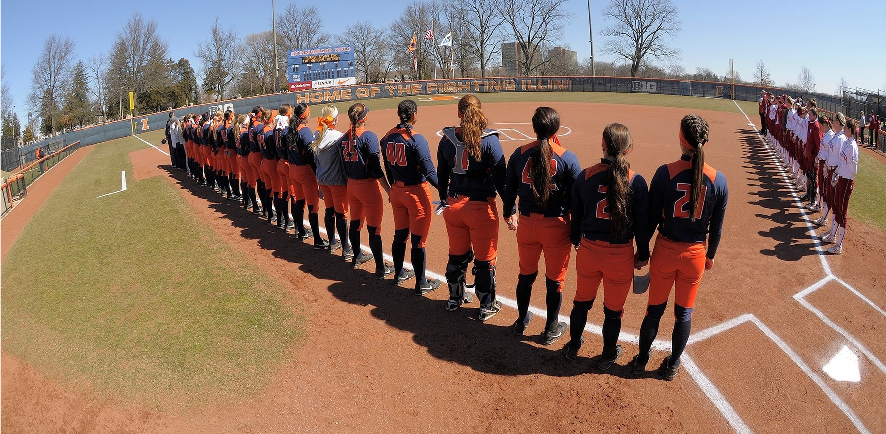 image of the Illini Softball team lined up before the start of a game
