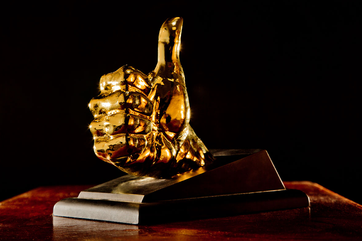 """Image of the Ebert """"thumbs up"""" trophy given to featured artists"""