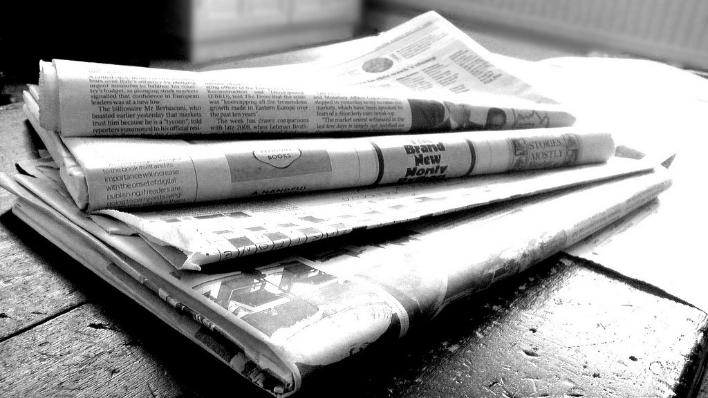 image of newspapers via wiki commons