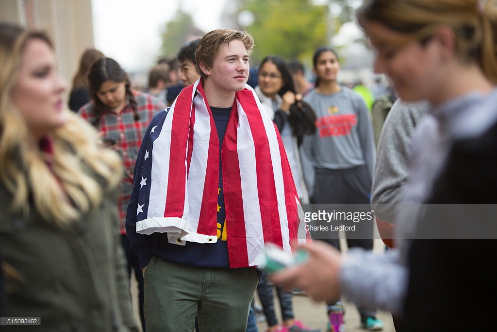 Image of a man attending a Bernie Sanders presidential campaign rally on campus. Photo by Charles Stretch Ledford