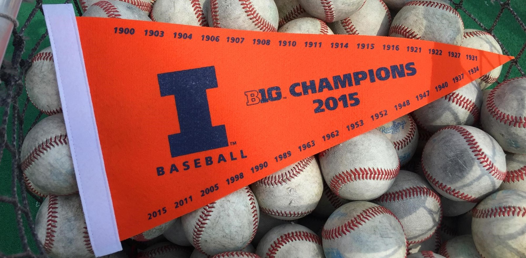 image of the Illini pennant surrounded by baseballs