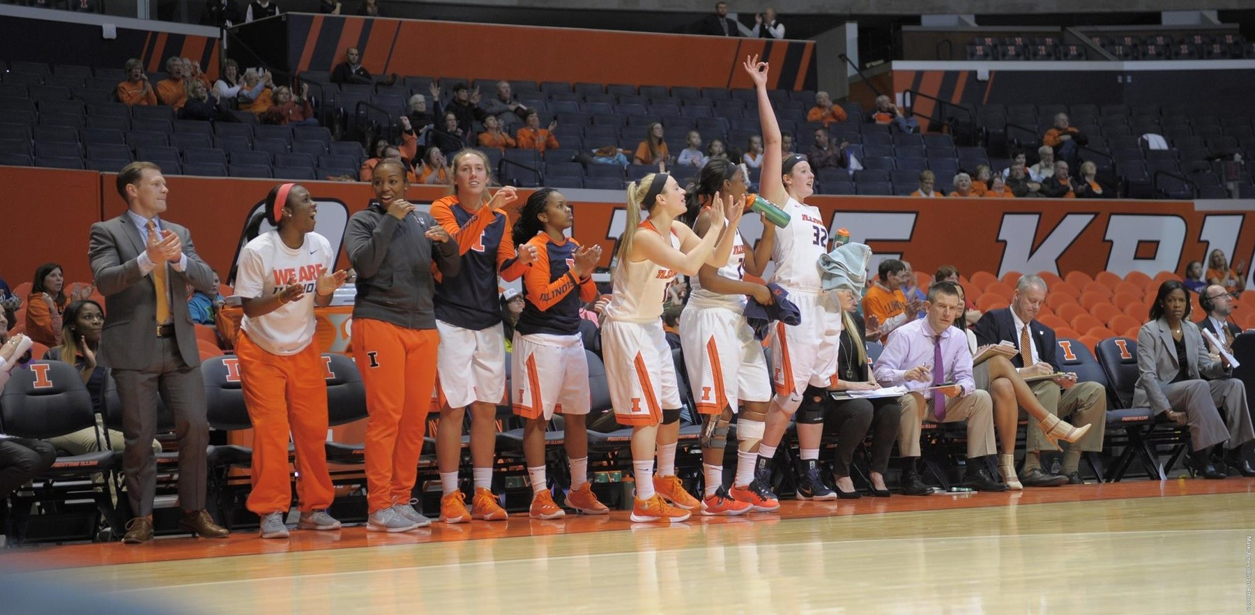 Image of players on the bench celebrating a three-pointer