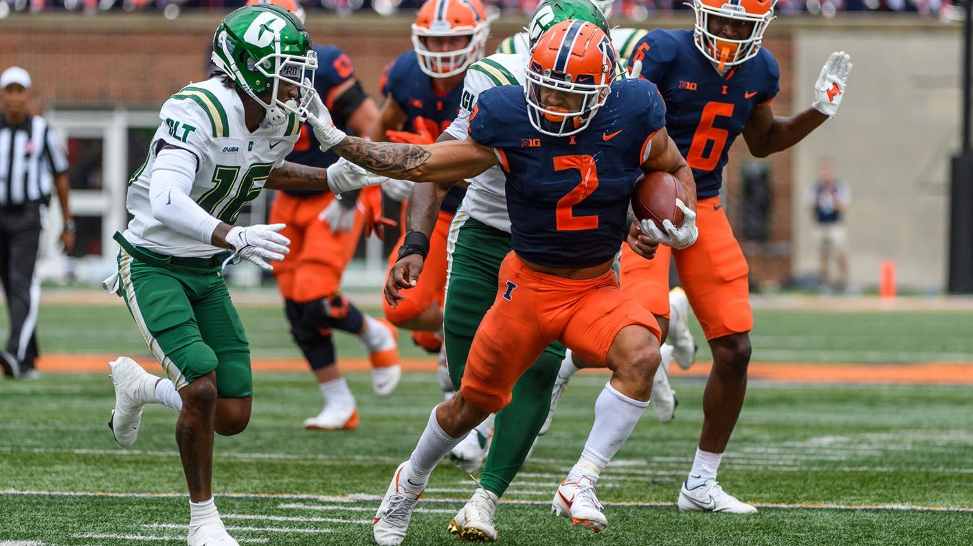 running back Chase Brown carries the ball against Charlotte