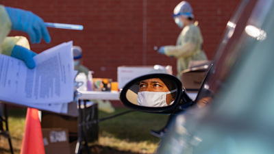 A patient listens to instructions from a worker at a pop-up COVID-19 test site conducted at the Rantoul Parks and Recreation Department.  Photo by Fred Zwicky