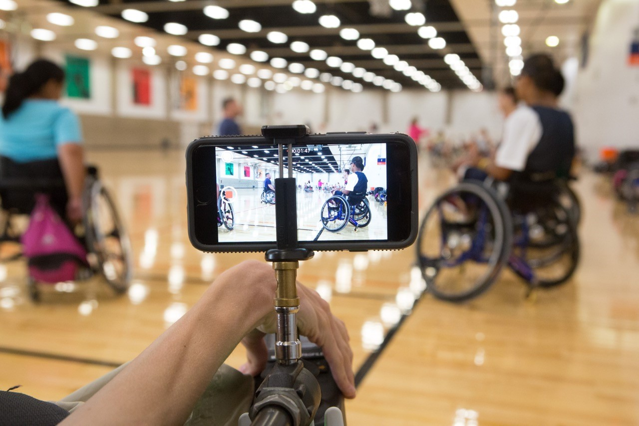 """Journalism student Ryan Wilson's """"ChairCam,"""" a device mounted to Wilson's wheelchair that he used to report on wheelchair basketball camps."""