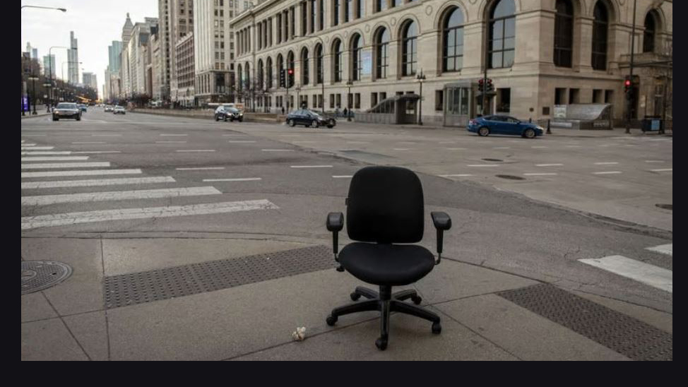 An abandoned desk chair sits in the middle of Michigan Avenue during Chicago's 5 p.m. rush hour. Photo by Brian Cassella for the Chicago Tribune