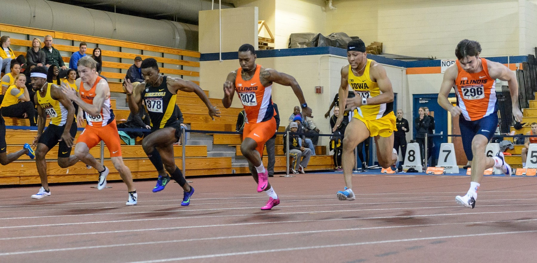 Illini runners begin a sprint against Missouri and Iowa competitors