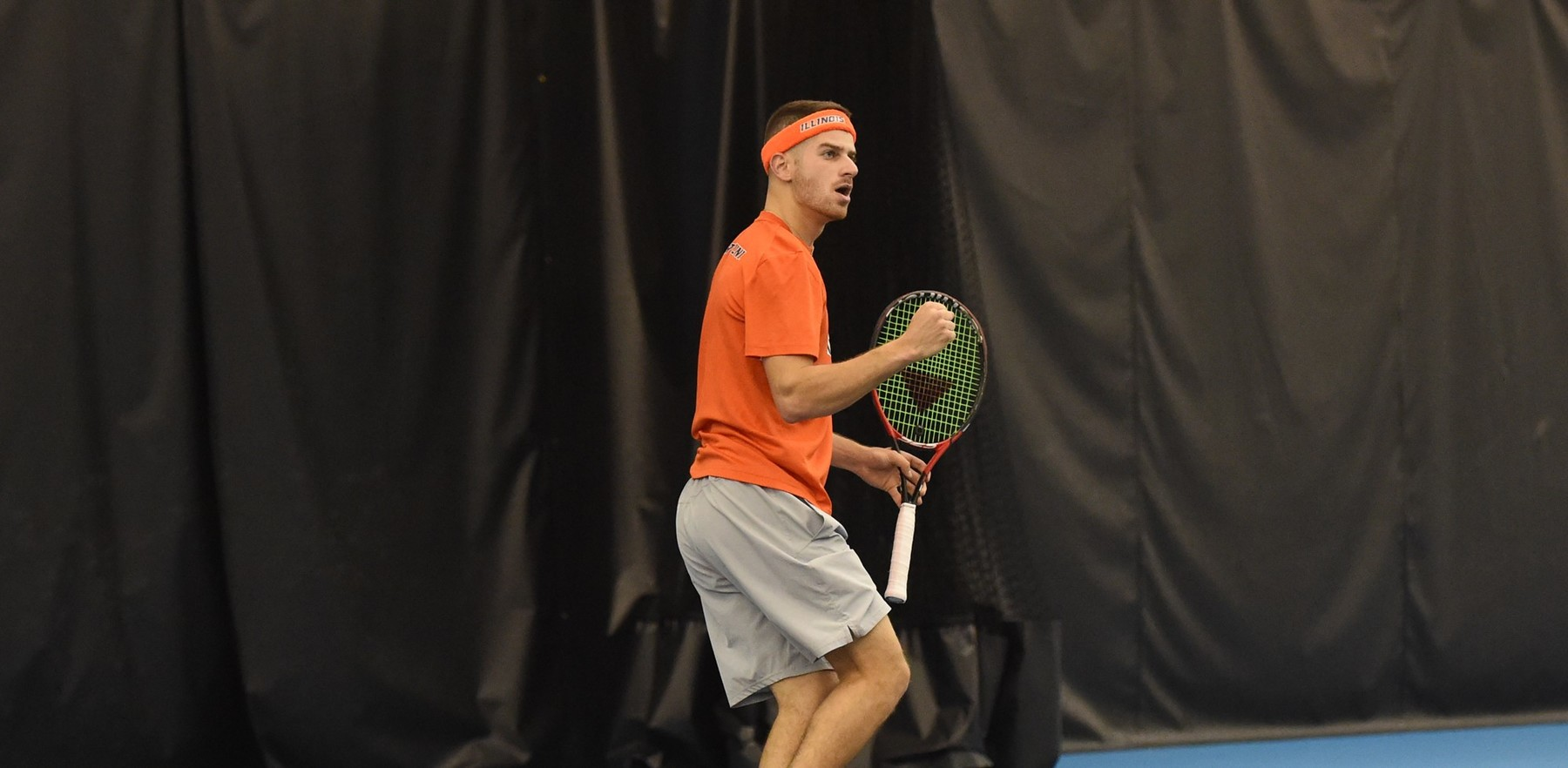Aron Hiltzik pumps fist after winning a point