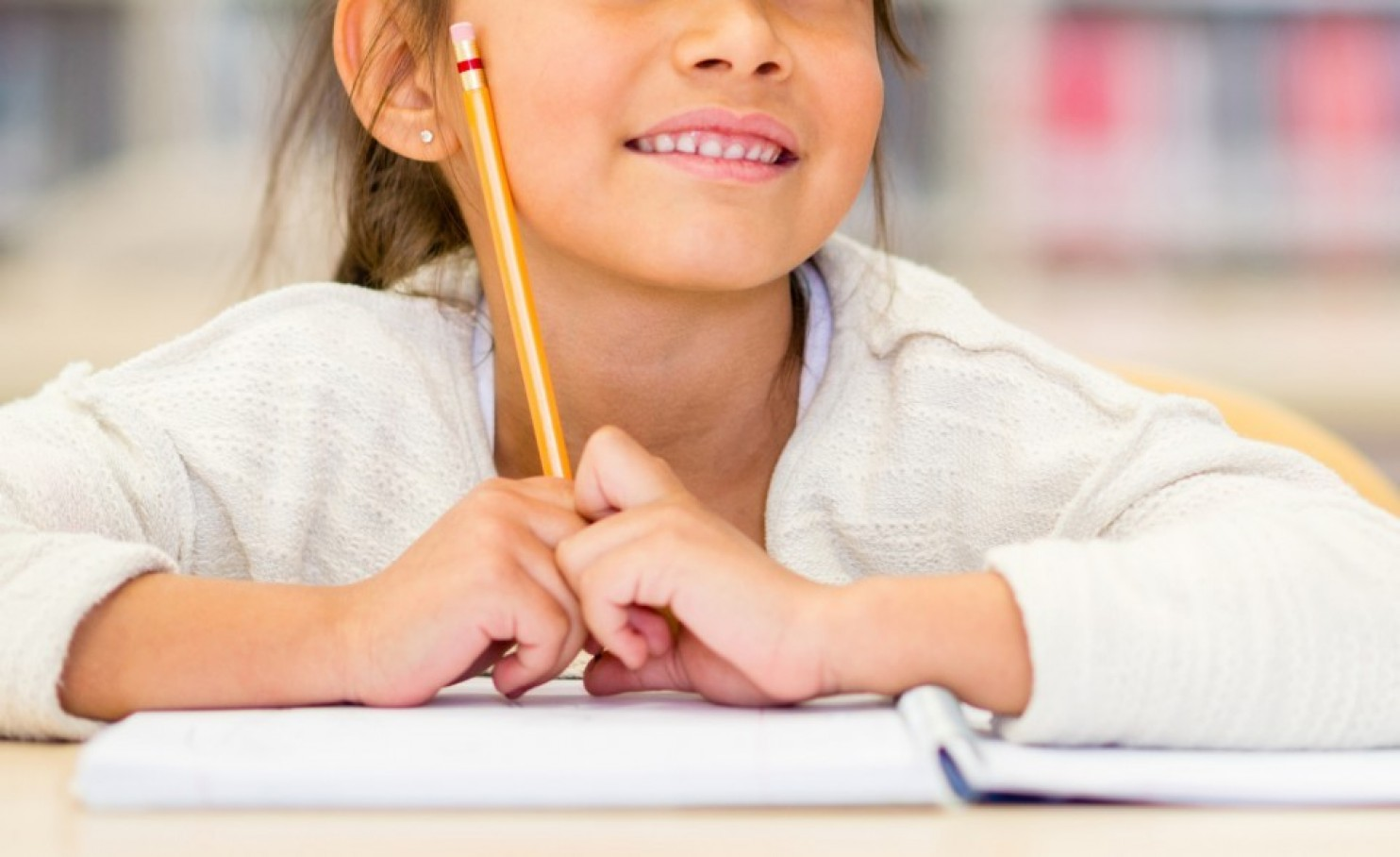 school girl with pencil and notebook. photo from iStock