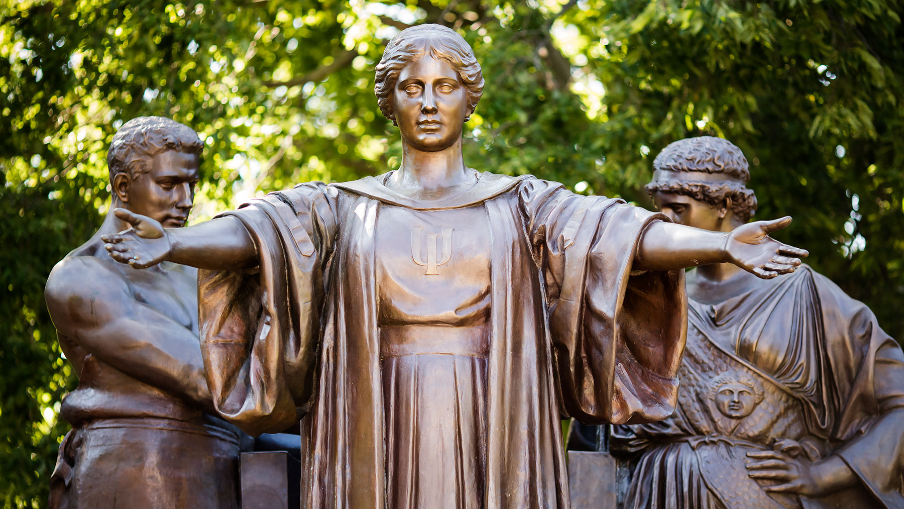 Alma Mater statue with arms wide to welcome all students
