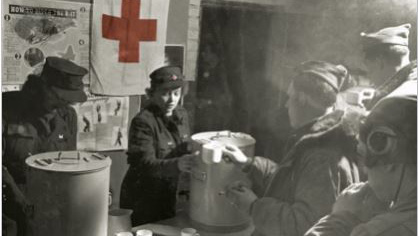As a Red Cross Clubmobile operator, Knappenberger was initially stationed at Glatton Airfield in England. She's shown distributing coffee