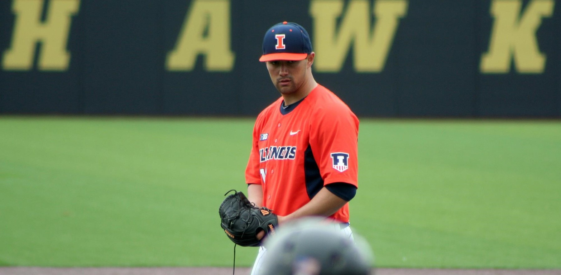 a right handed pitcher on the mound for the Illini