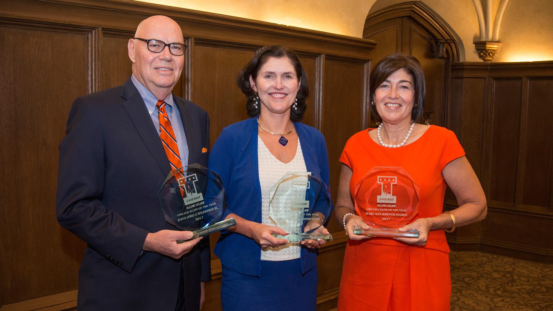 three award recipients post at the awards ceremony