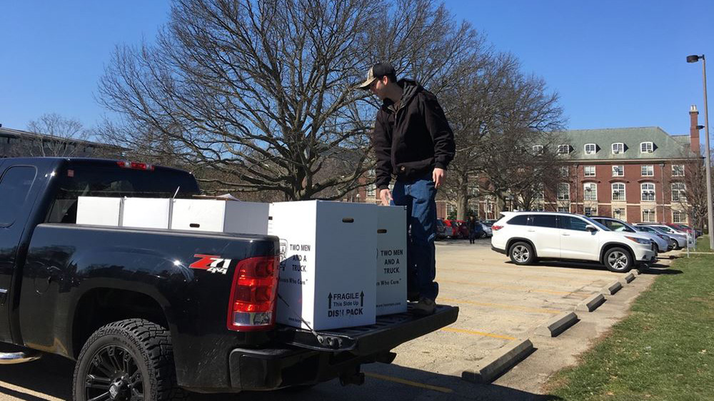 Conner Weber, a student at Illinois, unloads boxes for a food drive inspired in part by a history class on the Great Depression. Photo courtesy of Leslie Reagan.