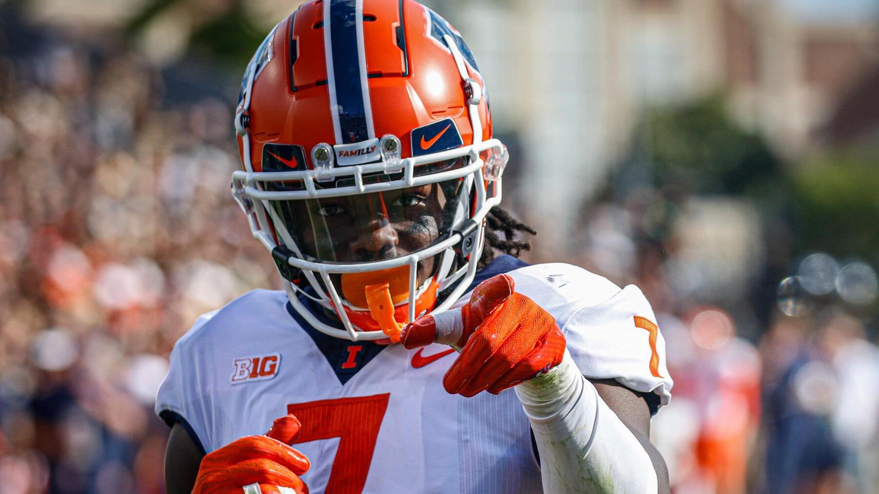 game action close-up photo of Illini Kendall Smith looking at camera and pointing finger