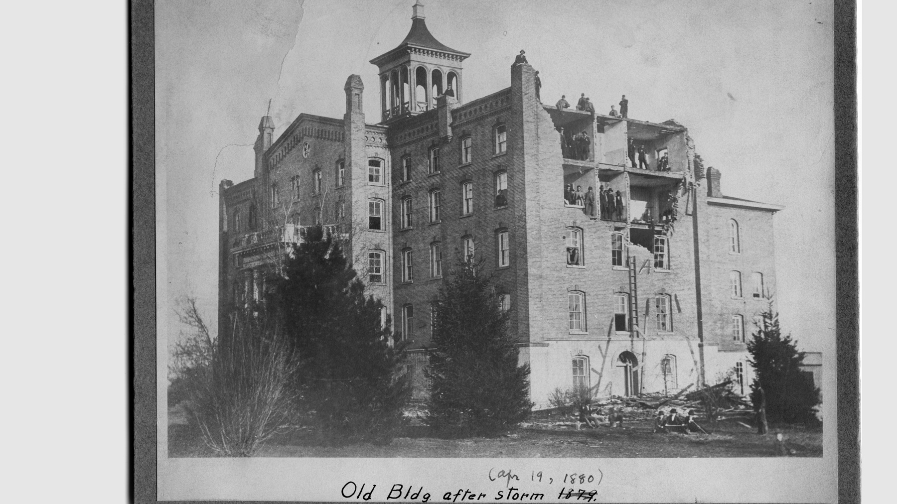 archival photo of the University's first building following the storm that destroyed the west side