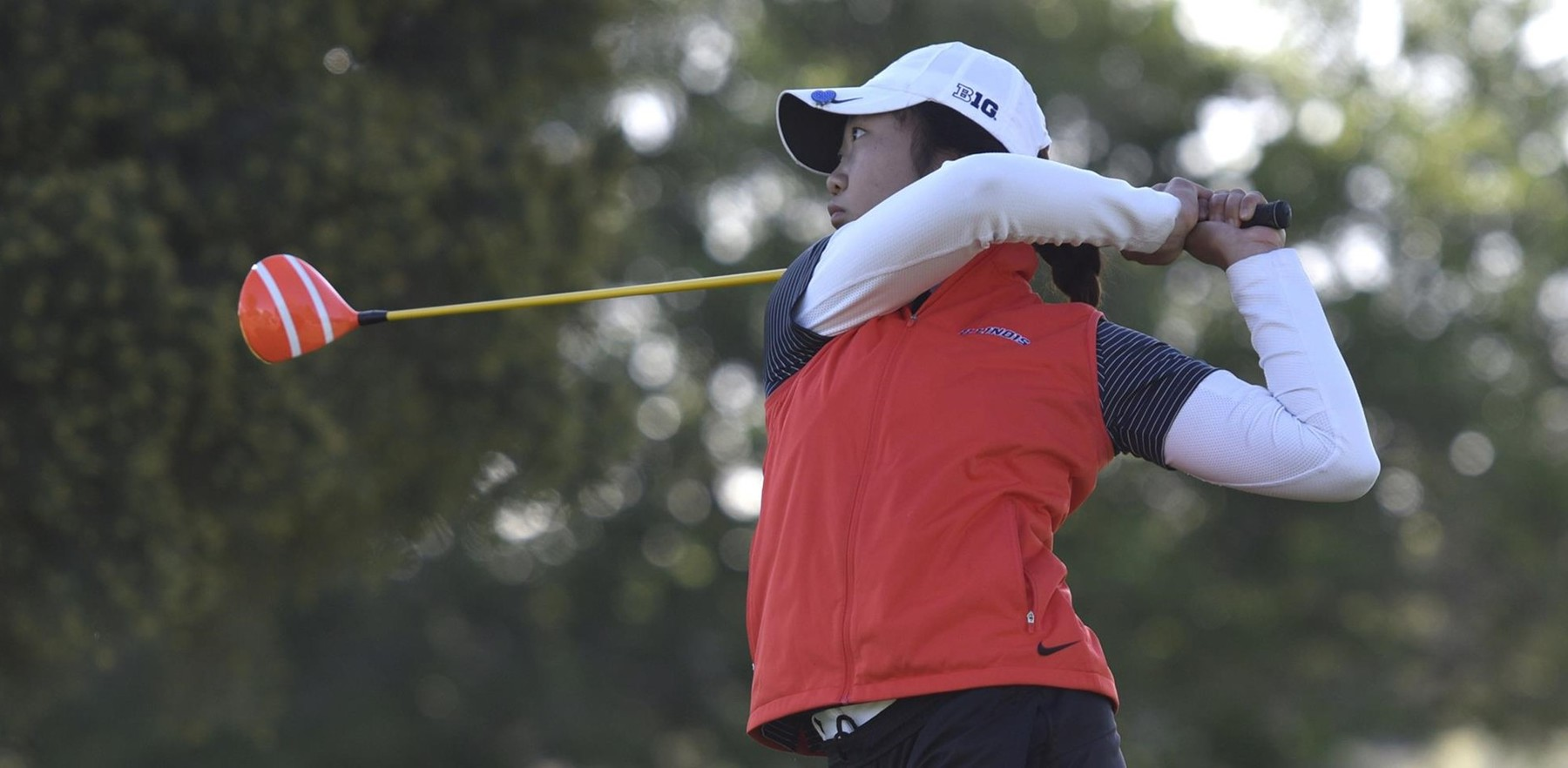 Illini junior Grace Park watches her ball after teeing off