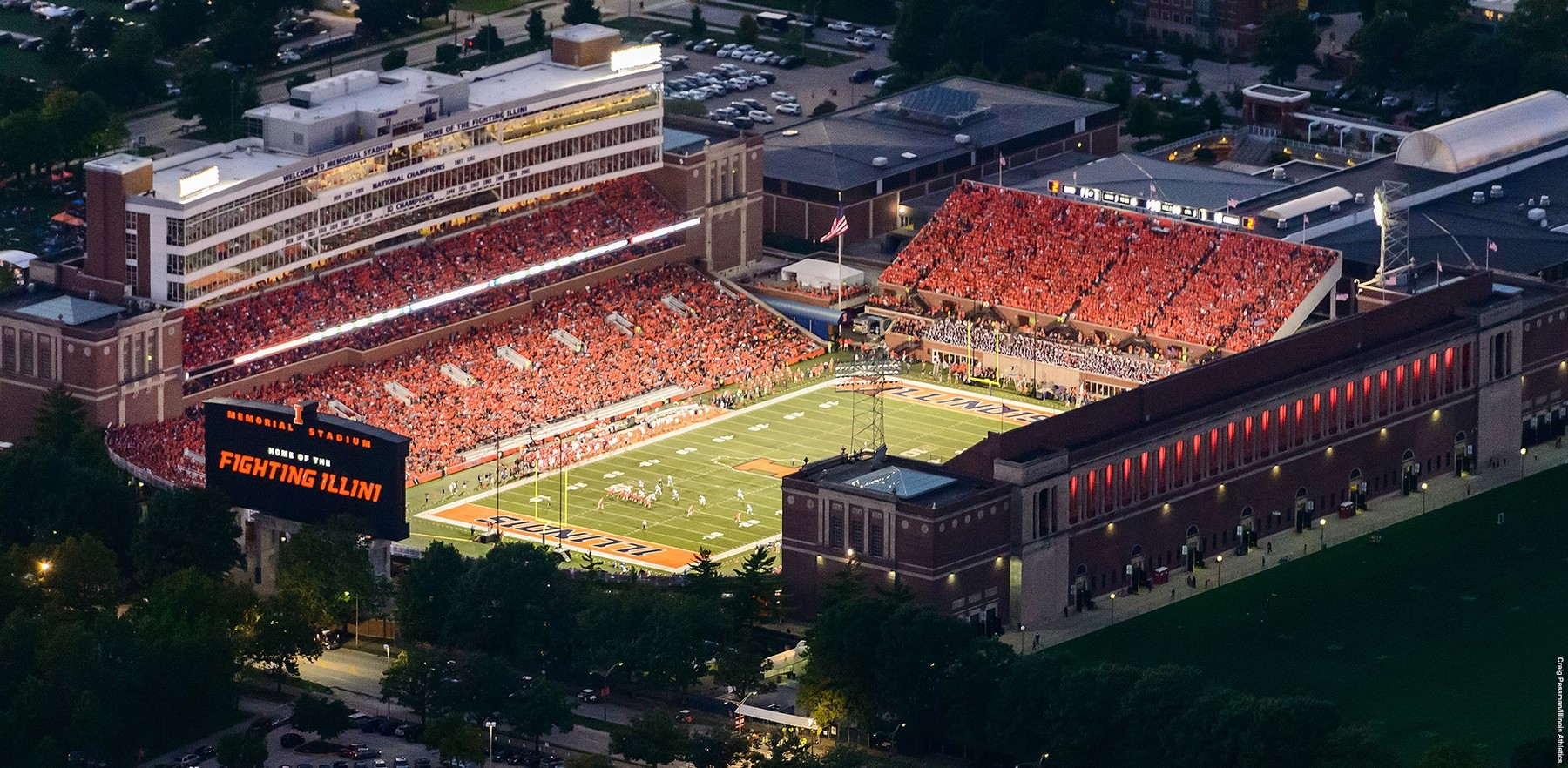 aerial image of Memorial Stadium lighted