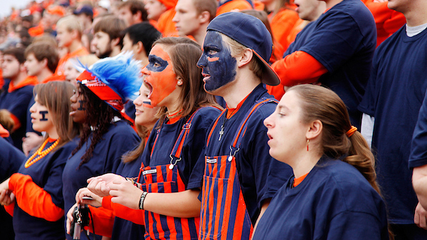 students in the 'Block I' cheering section of a Fighting Illini football game. Photo by L. B. Stauffer