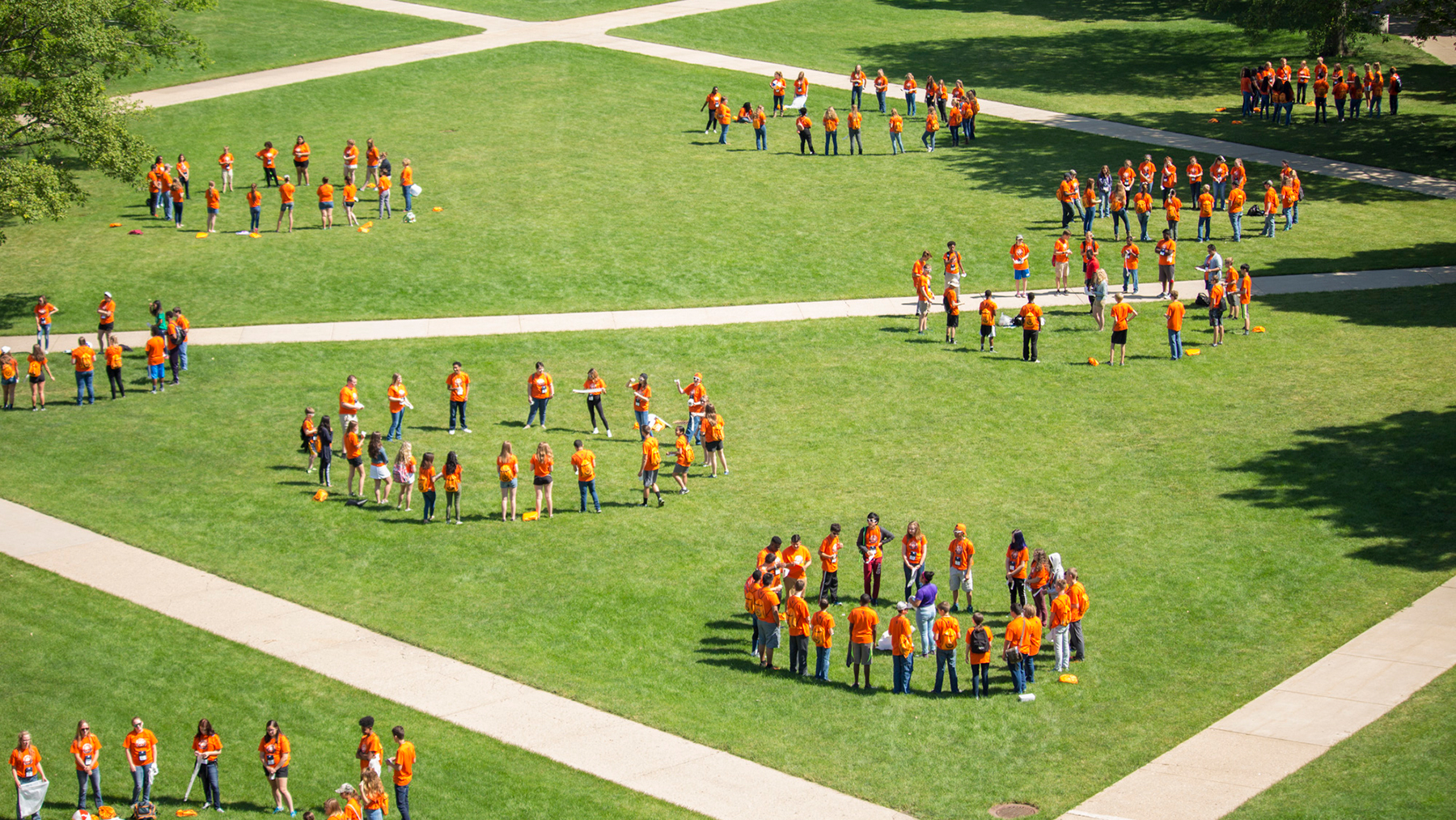 Attendees of the Illinois 4-H Illini Summer Academies form circles on the Quad.