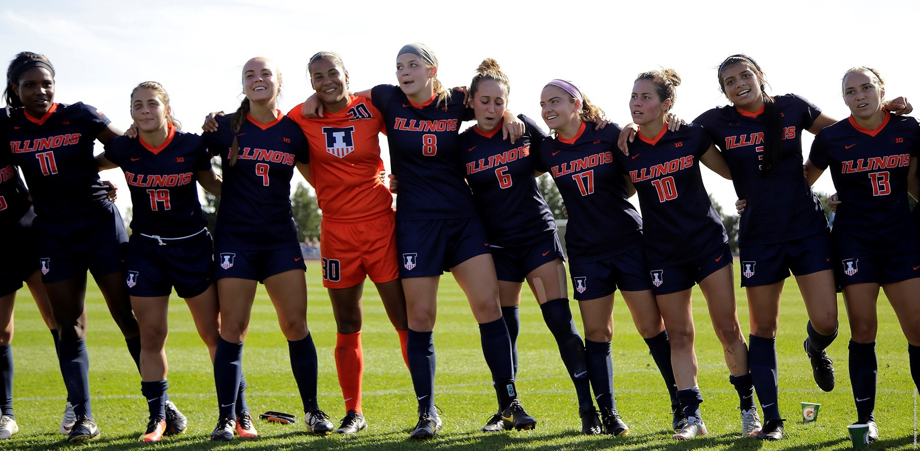 Members of the Fighting Illini soccer team link arms and sway